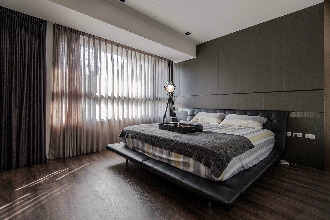 Stone and wood make a dark masculine interior for Manly bedroom decor