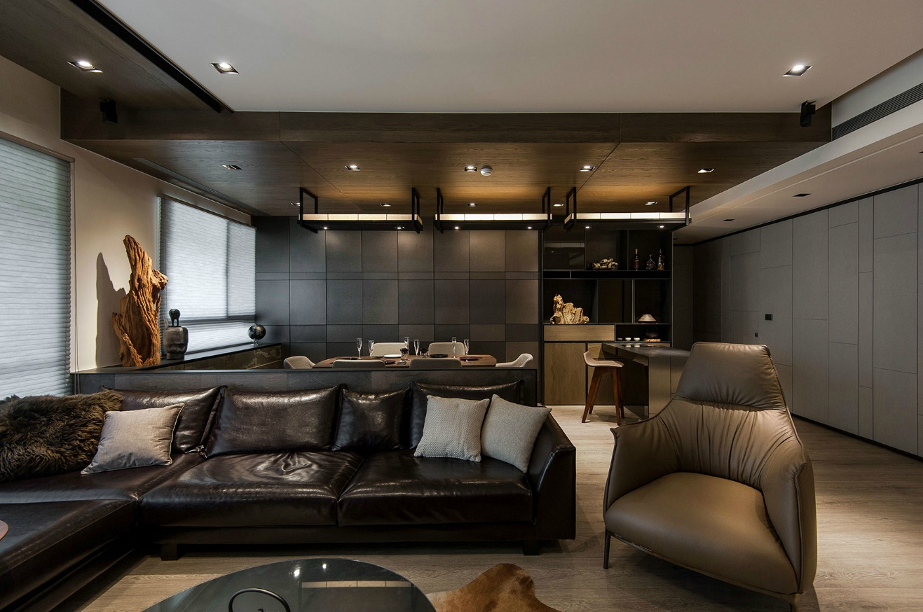Stone and wood make a dark masculine interior for Salon noir et beige