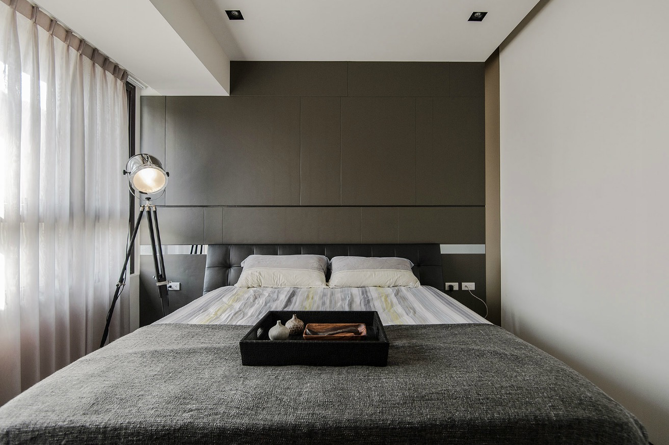 Stone and wood make a dark masculine interior for Interior bedroom minimalist
