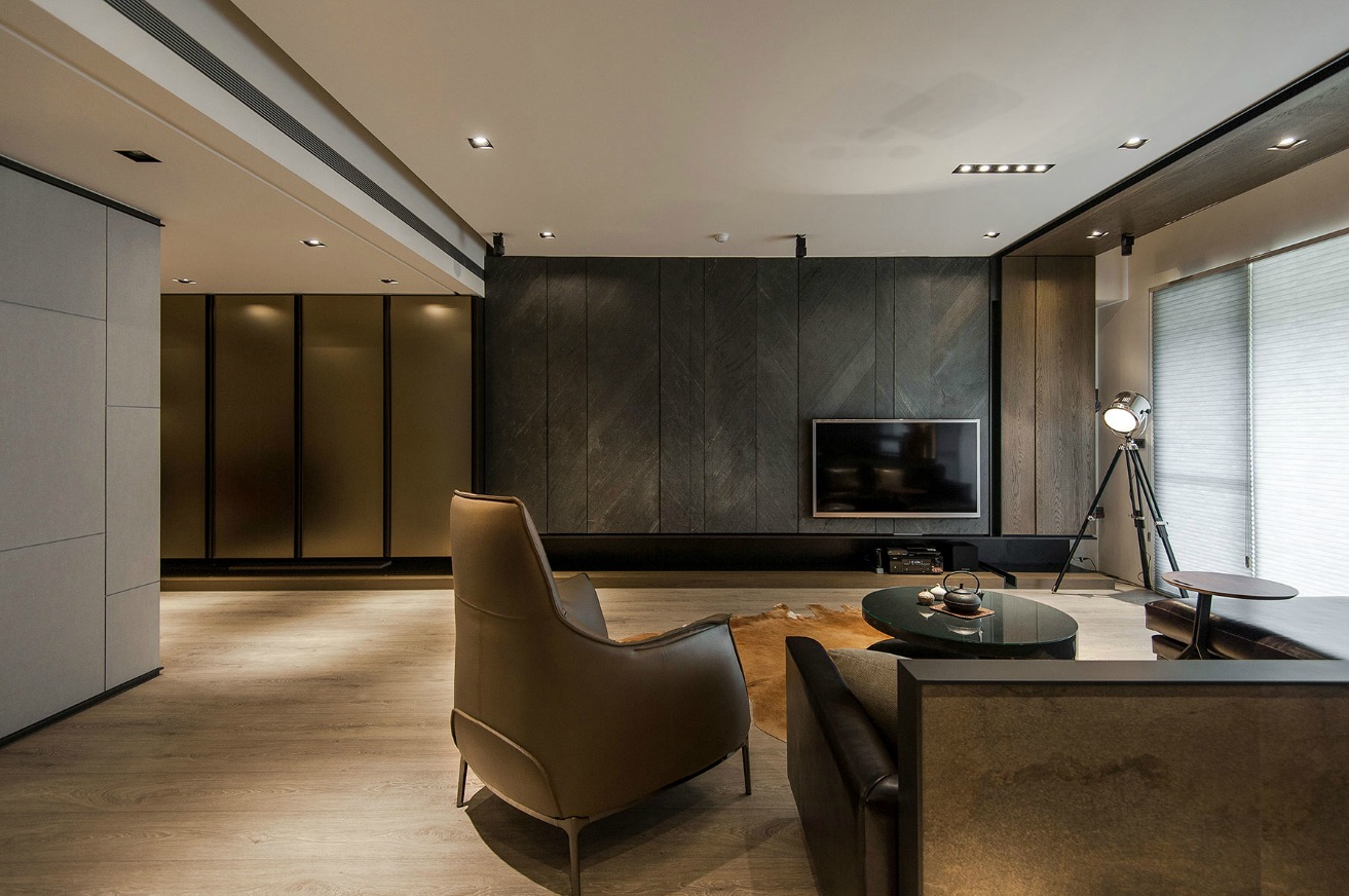 Stone and wood make a dark masculine interior for Minimalist living space