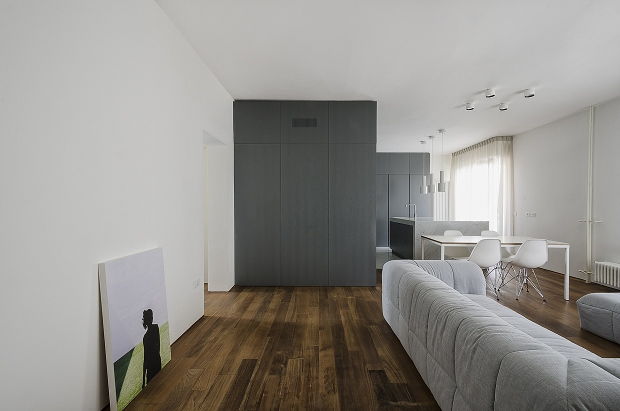 Pinstripe Paneling - Italian apartment renovation brings open space to 1960s home
