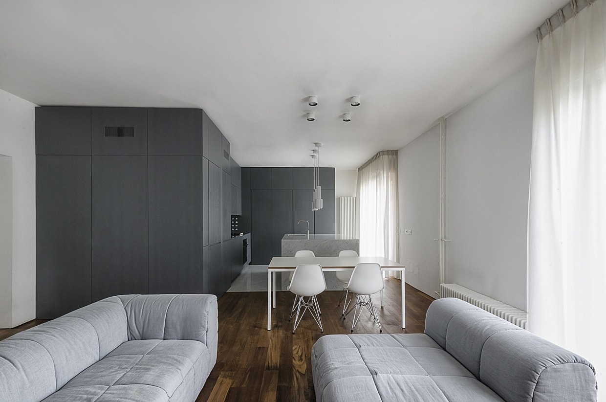 Soft Gray Sofas - Italian apartment renovation brings open space to 1960s home