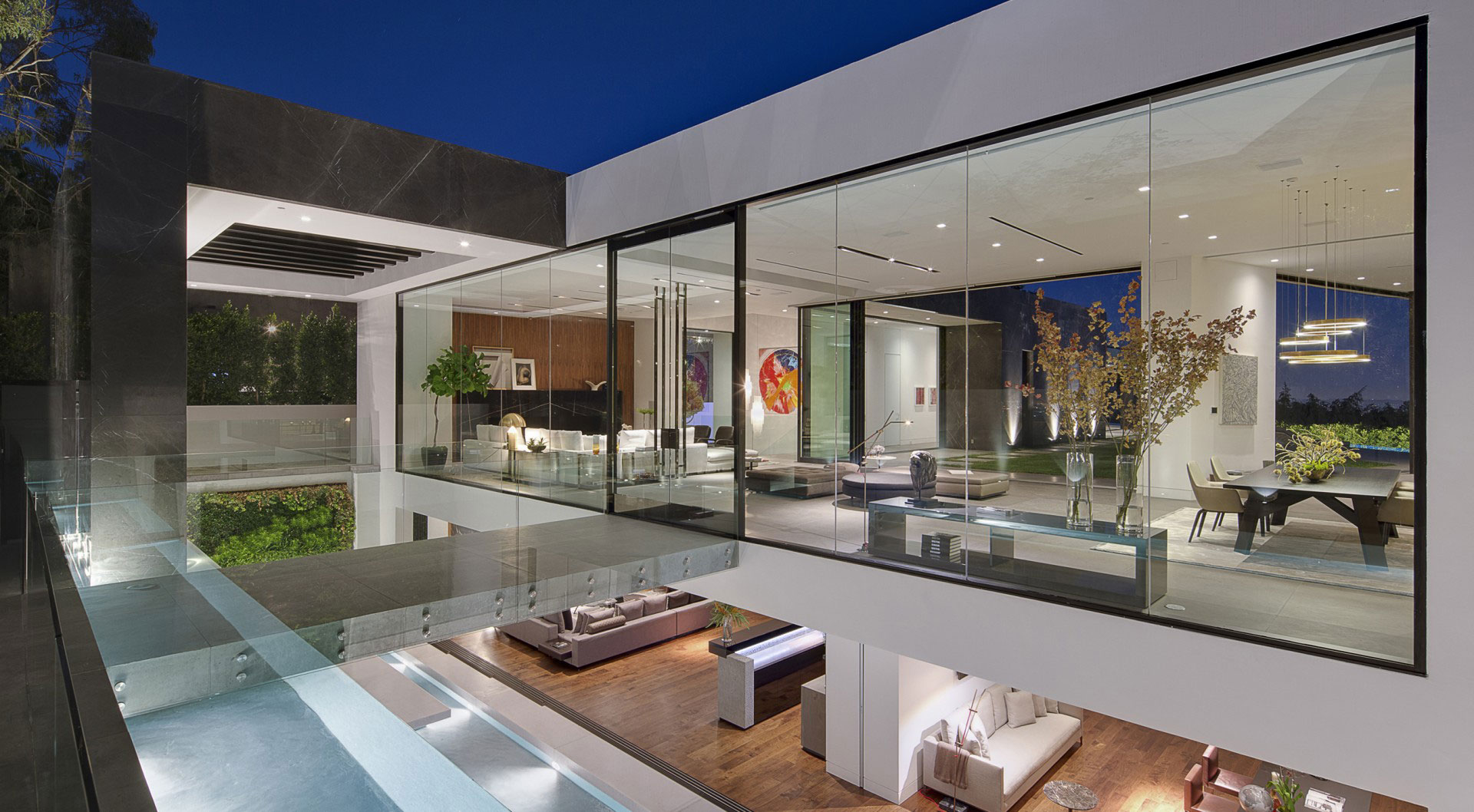 A dramatic glass home overlooking the l a basin for Glass front house plans