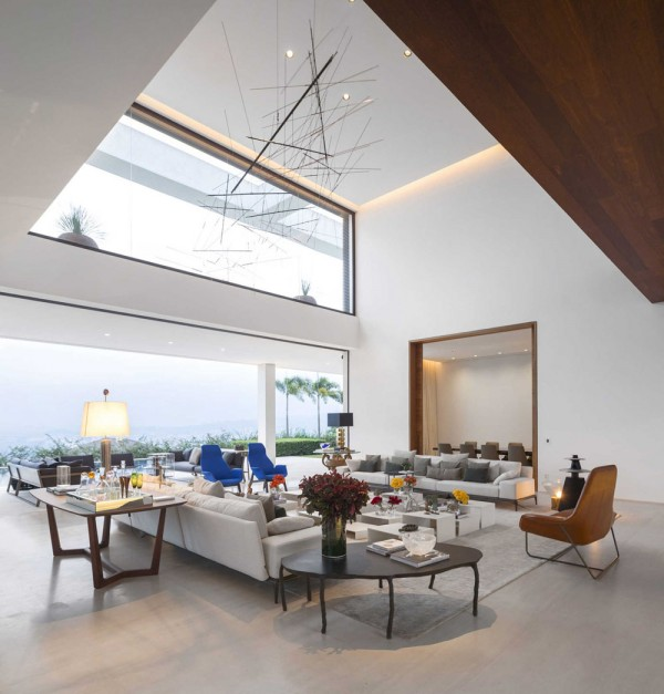 When coupled with soaring ceilings, the furniture topography (as the designer artfully calls it) makes the space feel even larger, more open, and full of imagination.  The living area, in particular, has its ceiling doubled with height.