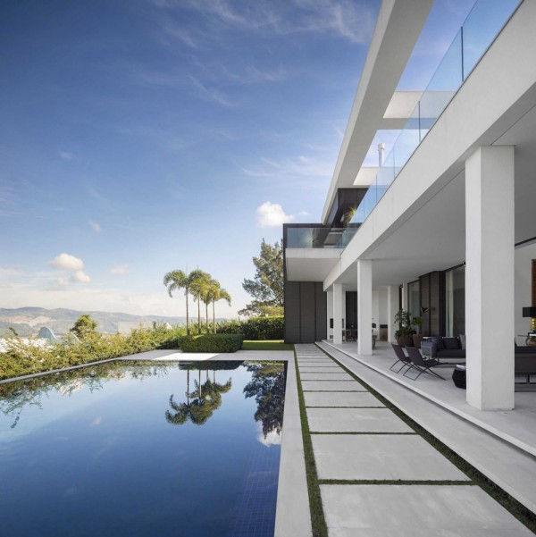 The pool area, in keeping with the theme, takes on an infinity feel with breathtaking views. The use of sharp angles and clean lines in the exterior stonework is tempered by the soft curves of the surrounding mountains and lush vegetation. This is an area perfect for family entertaining.