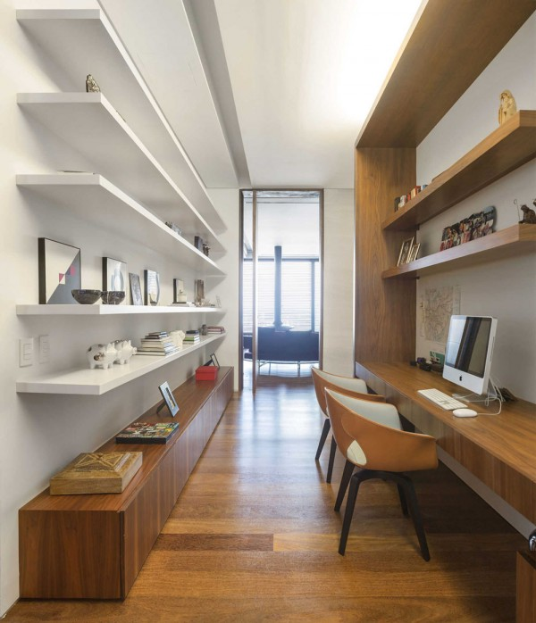 While the office is a smaller space, it is well organized with plenty of open shelving and ambient lighting without being harsh. It's set away from the living areas as to lend a sense of solitude for concentration, but it's still easily accessible and flows seamlessly through the rest of the ground floor design.