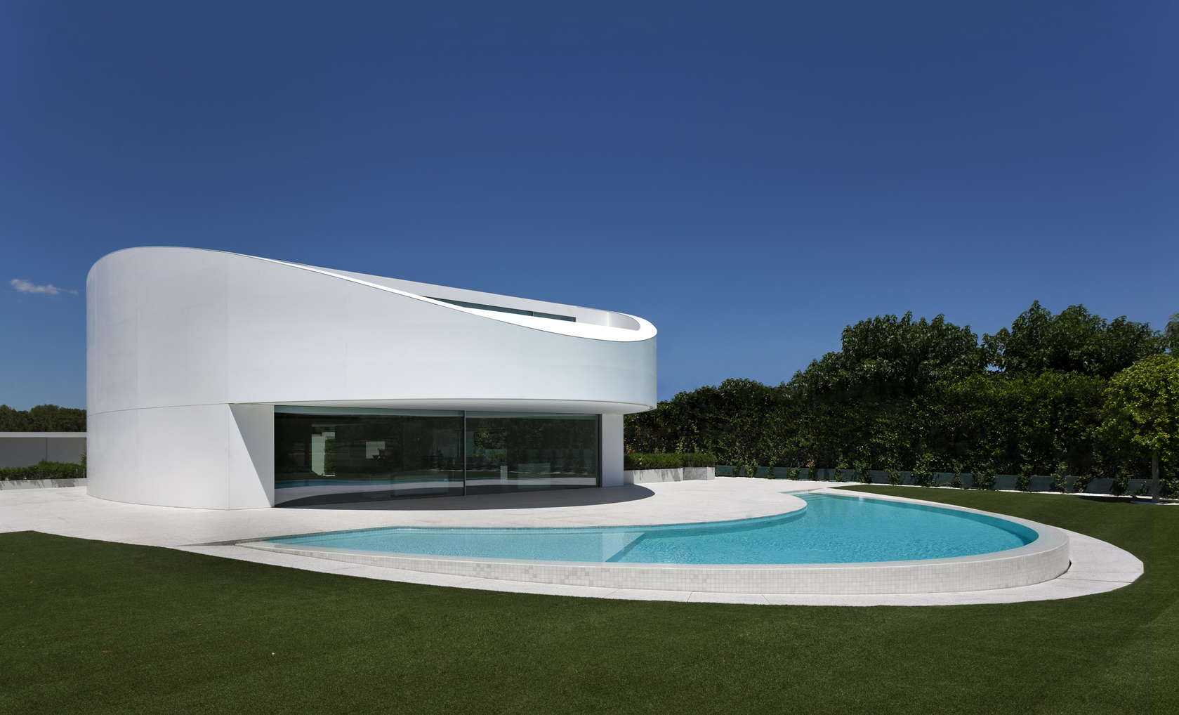 Amazing House Exterior - Golf course views and a striking exterior make for a modern marvel