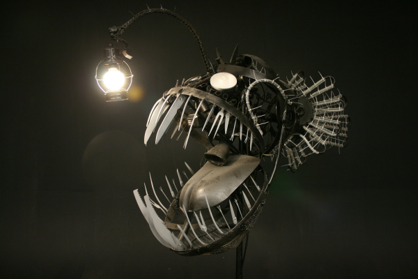 This angler fish lamp was made from recycled objects and uses an energy efficient lightbulb.