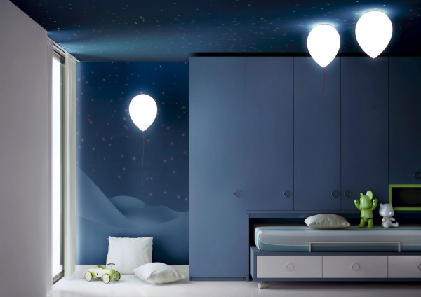 Balloon lamps from CrousCalogero appear to be floating, hiding low consuption fluorescent bulbs inside.