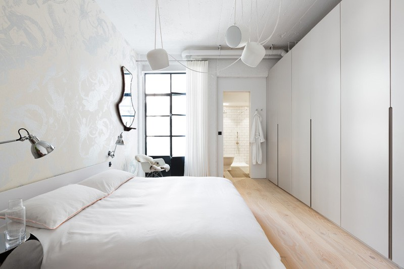 Light Wood Flooring - Converted industrial space becomes a pretty sunny apartment