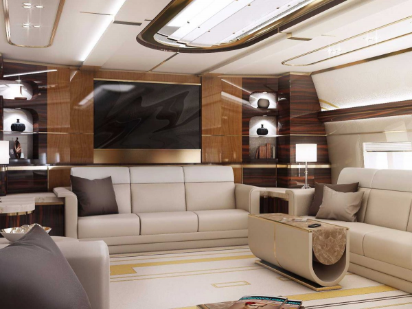 It would be surprising enough for most of us to see a sofa in a plane. But an entire lounge with multiple sofas, a coffee table, and a wall mounted flatscreen? That's a far cry from a little extra legroom.