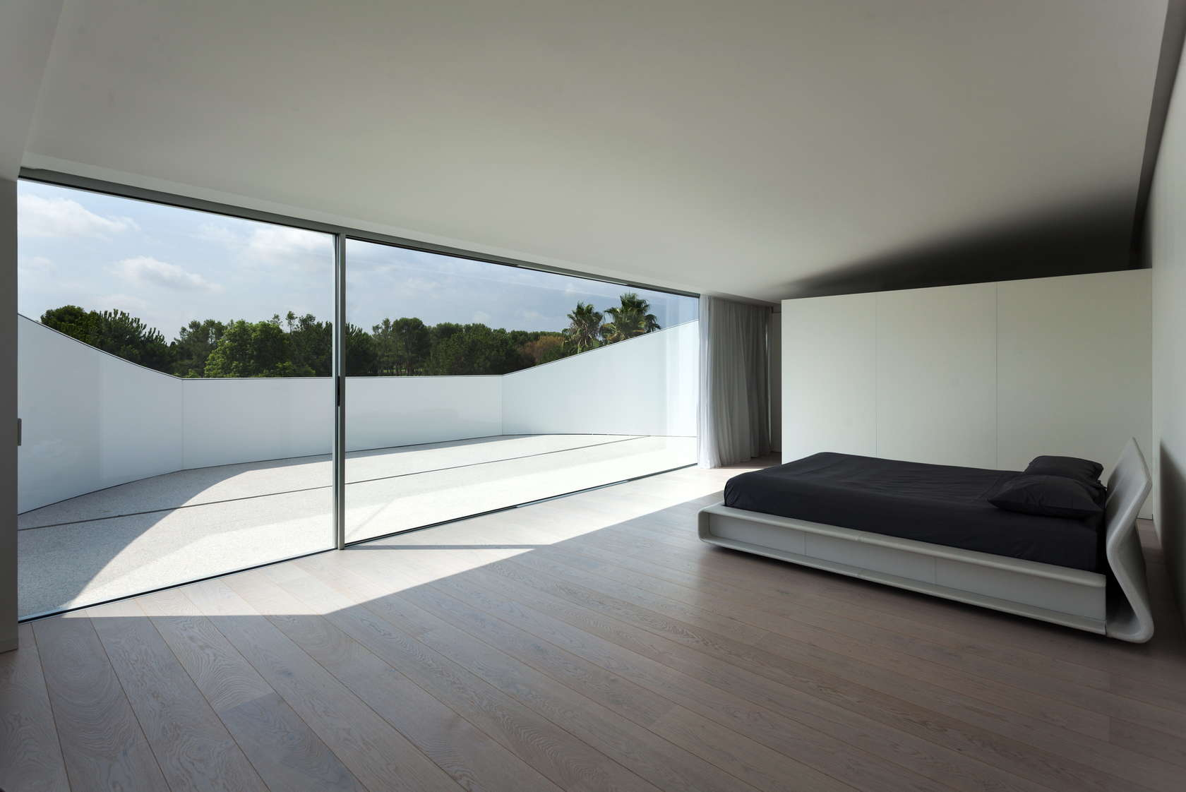 Moden Bedroom - Golf course views and a striking exterior make for a modern marvel