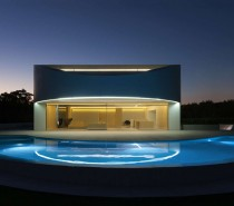 The outdoor space of the home emphasizes curves, ellipses, semicircles, even bringing these smooth rounded edges to the pool design. The curves make the open space feel even bigger than it is, inviting comparison to the natural (but manicured) expanses that surround the house.