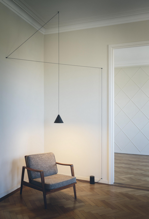 Simple and sophisticated, this suspended reading light is a gorgeous addition to any room.