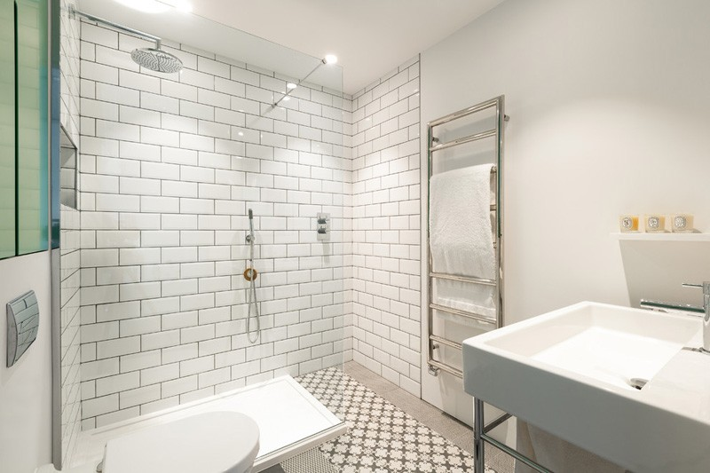 White Tile Bath - Converted industrial space becomes a pretty sunny apartment