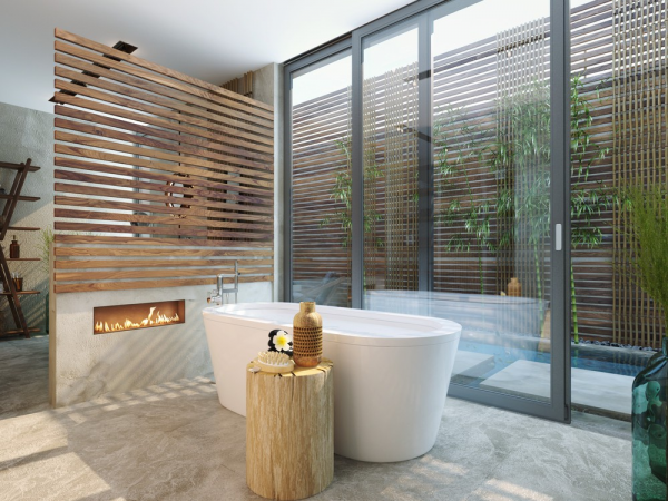 Next up is a warm, luxurious bathroom with tropical theming. Wood slat accents, a fireplace facing the deep soaking tub, and the rainforest-inspired shower make this a real luxury retreat that would be well suited to a vacation resort - or a particularly lucky home.