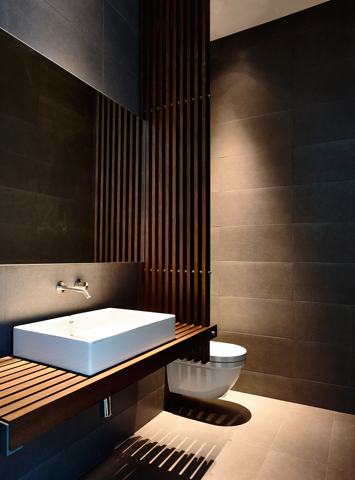 Wood slats add texture and warmth to these homes for Toilet interior ideas