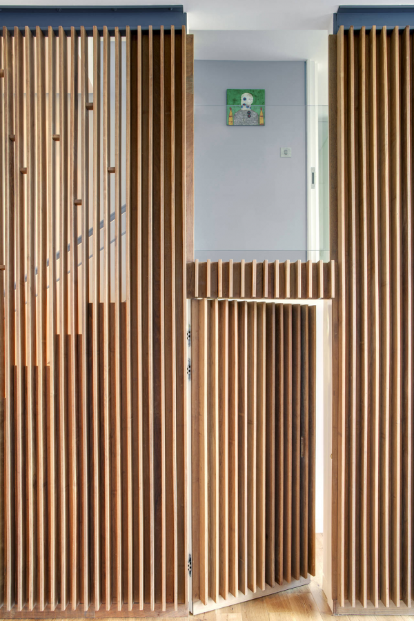 Wood slats add texture and warmth to these homes