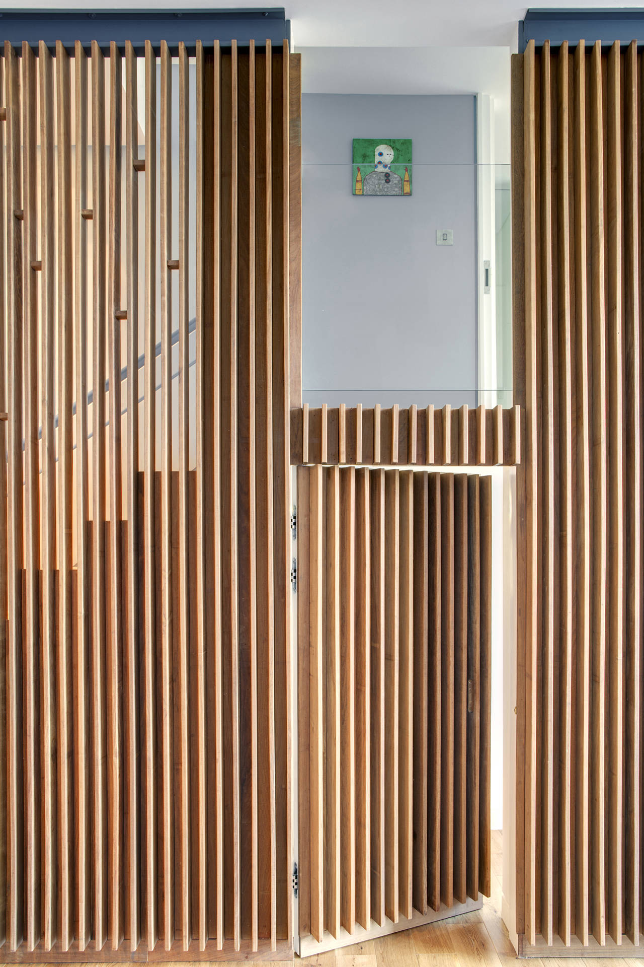 Wood slats add texture and warmth to these homes for Cloison interieur bois