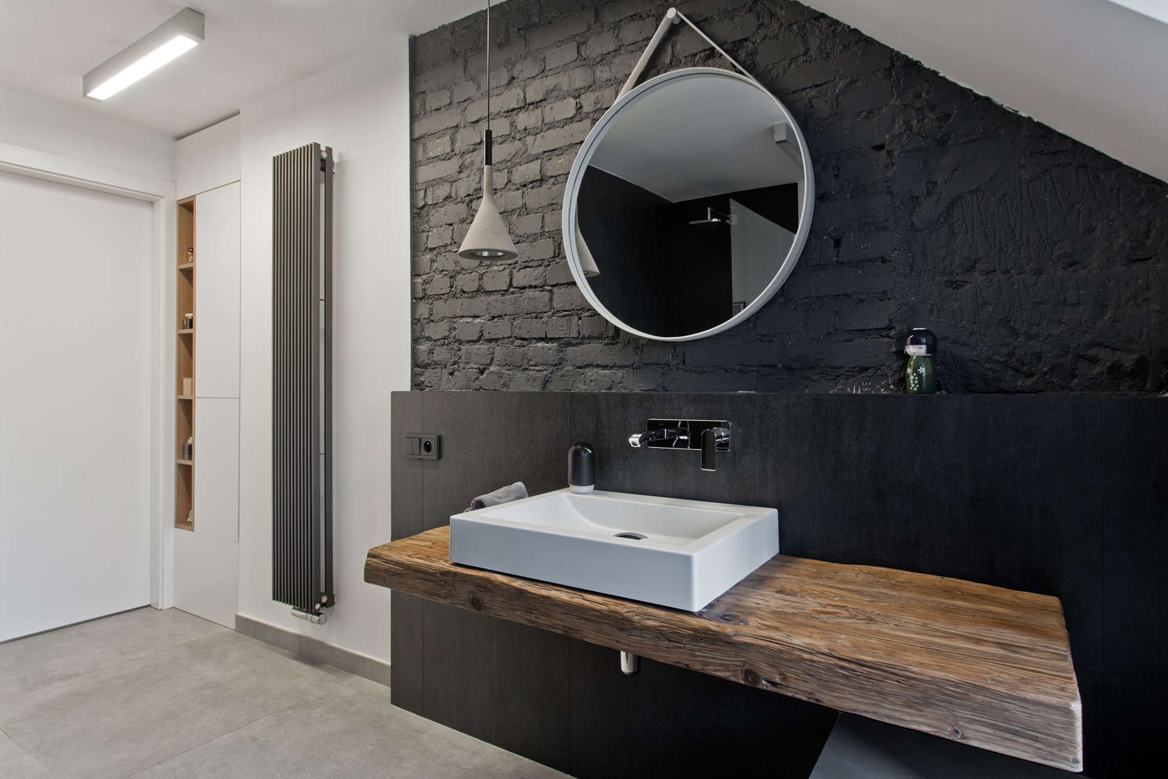 Black Painted Bricks - An old attic is transformed into a gorgeous apartment