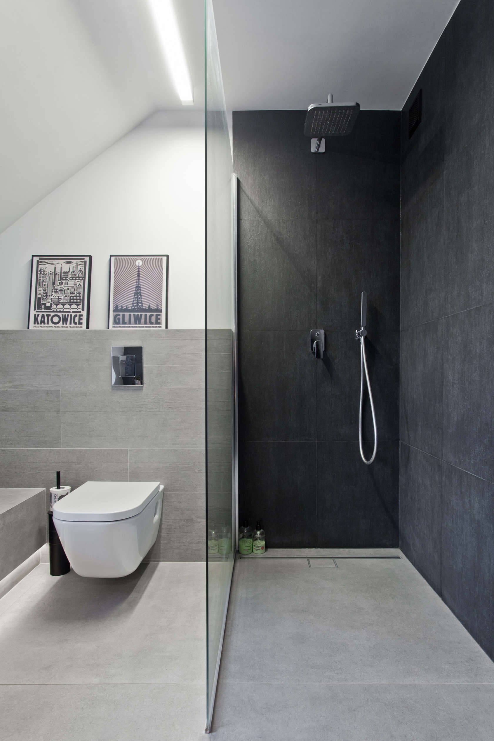 Dark Gray Shower - An old attic is transformed into a gorgeous apartment