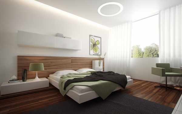 By letting the hardwood flooring creep up the wall, the bed becomes a welcoming nest in this room.