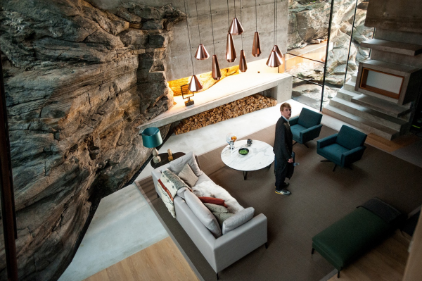 Some of the home interiors, such as these of the living room, were shot a separate location. A private summer house, also designed by Jensen & Skodvin, speaks to the themes of the movie. The home and its sleek modern aesthetic is actually carved into the side of a mountain. Cliffs and rocks come into the house and must be worked around, just as the film uncovers so many elements of the nature that man is up against when working with technology.