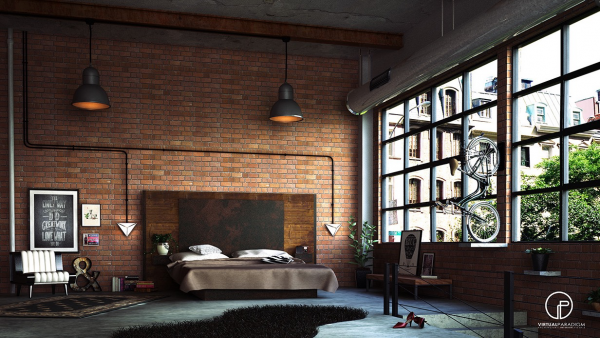 An exposed brick wall give this loft bedroom a trendy industrial look.