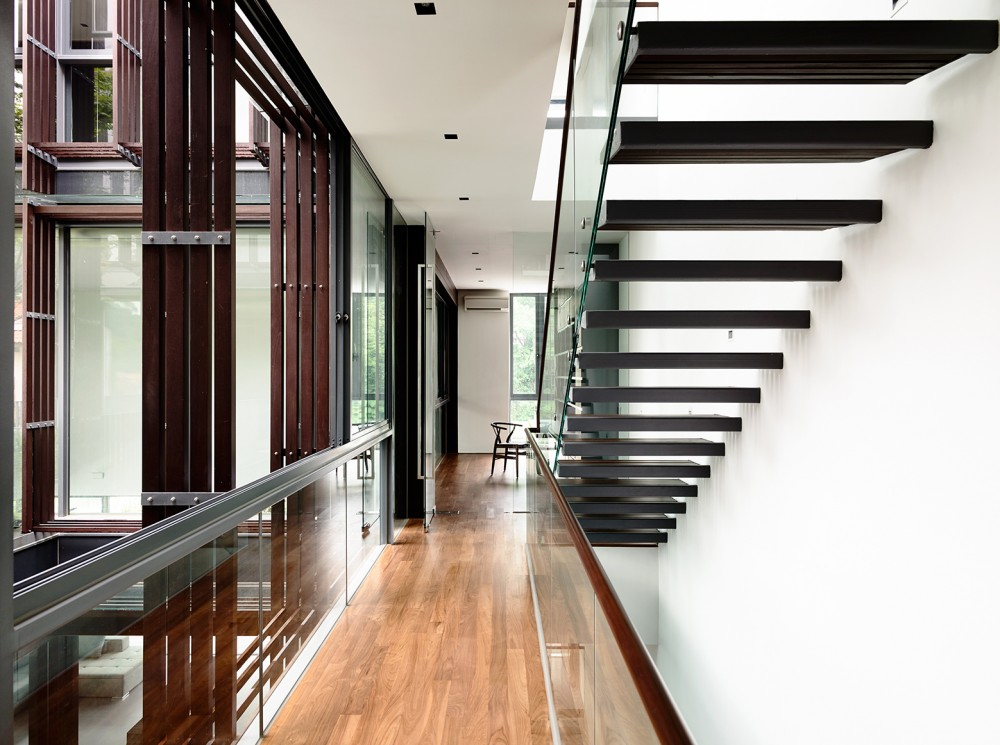 Floating Staircase - Open tropical home with interior courtyard and wood features