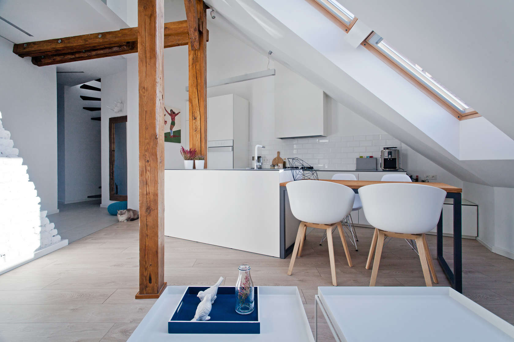 Molded White Chairs - An old attic is transformed into a gorgeous apartment