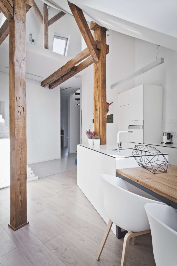 An old attic is transformed into a gorgeous apartment for Natural wood beams