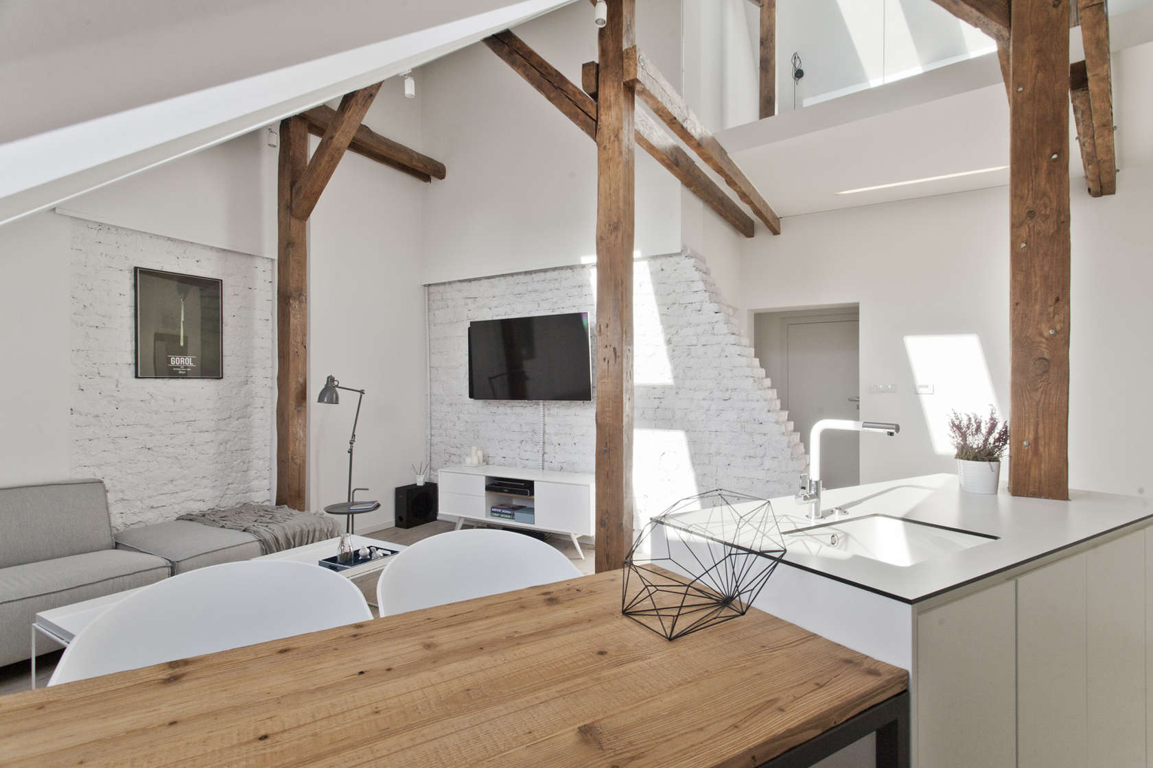 Natural Wood Tables - An old attic is transformed into a gorgeous apartment