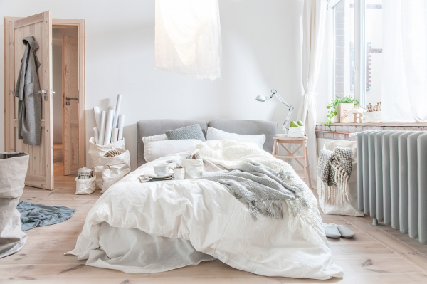 A bit of romance infiltrates this feminine bedroom with lots of sunlight.