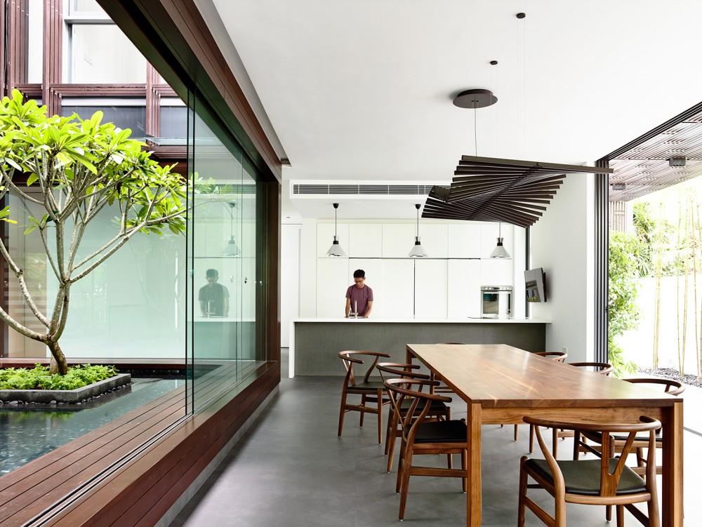Simple Wood Dining Table - Open tropical home with interior courtyard and wood features