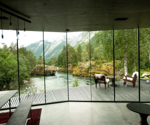 Much of the home used in the final film is actually a hotel. The Juvet Landscape Hotel, from the Norwegian team at Jensen & Skodvin Architects. Although the film takes place in Alaska, this stunning hotel is actually found in a remote area of Norway. The hotel, which has not been open long, is nestled among rocks, forests, and water. It plays the part of the billionaire's dining room but is also available for booking - if you can afford it.