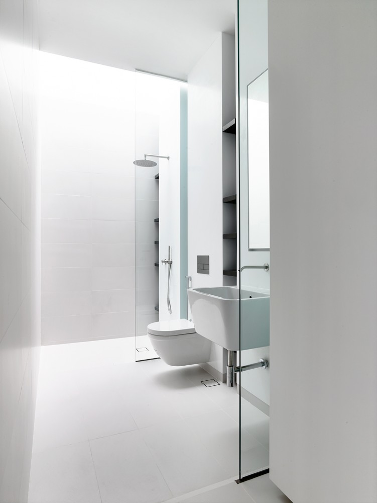 White Bath Design - Open tropical home with interior courtyard and wood features