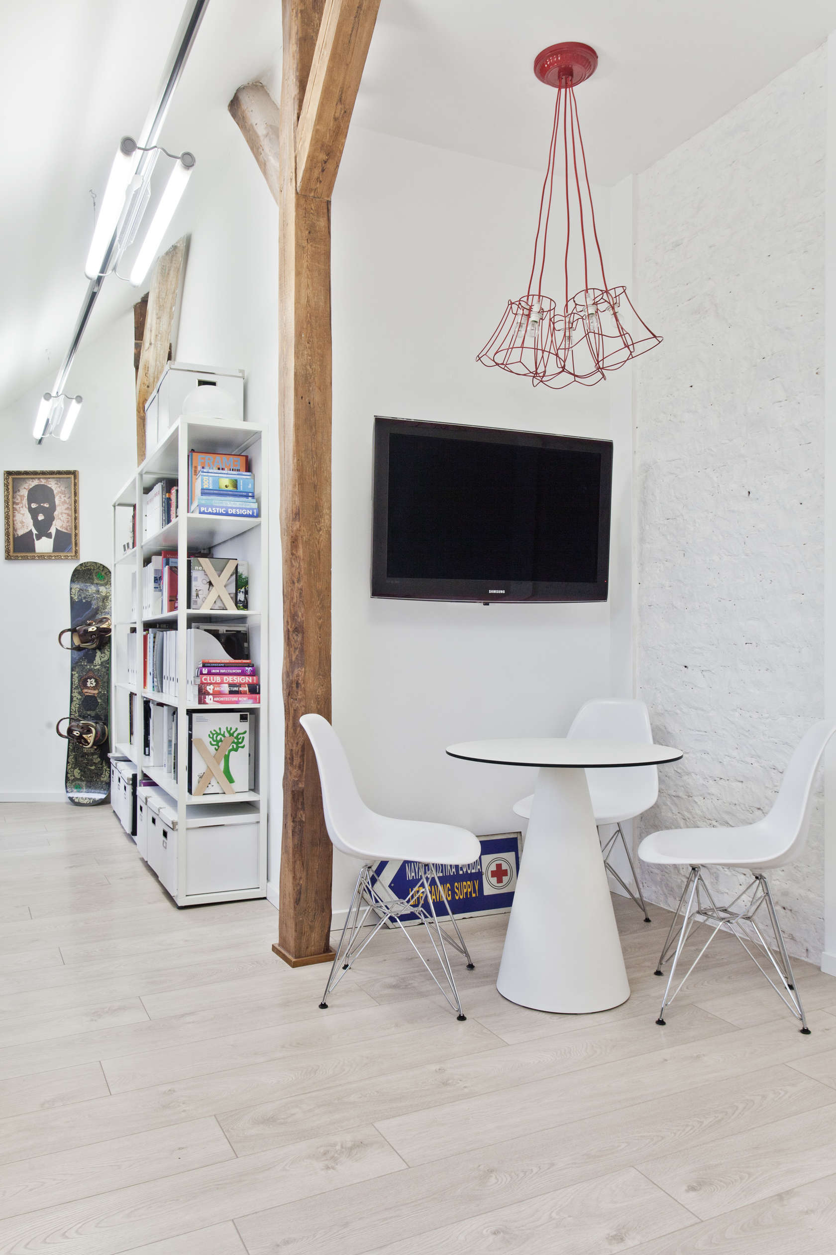 White Molded Eames Chairs - An old attic is transformed into a gorgeous apartment