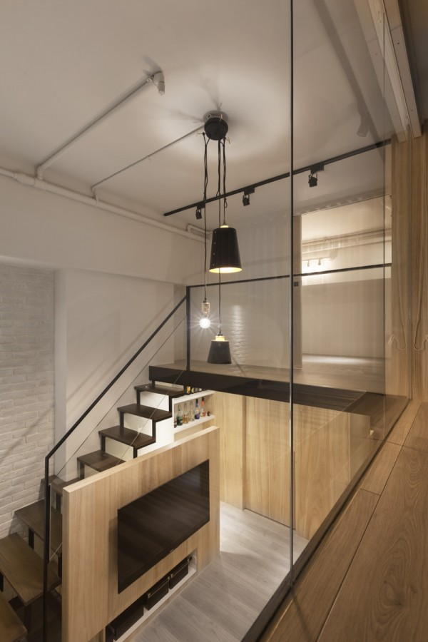 At night, a blend of industrial fixtures and recessed lighting work together to create a calming atmosphere.