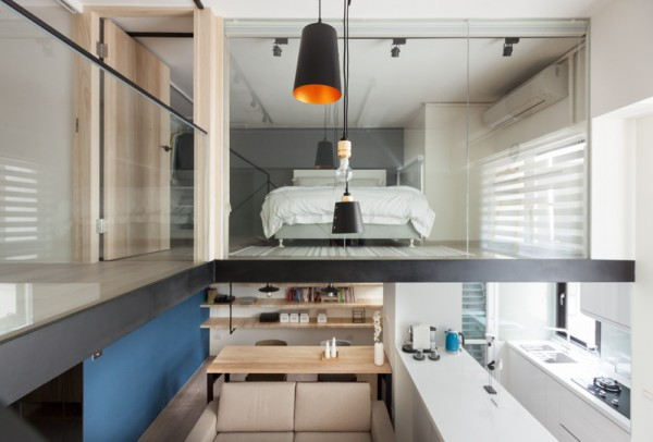 The lofted bedroom takes advantage of the natural light spilling in from the windows in the kitchen and main living area.