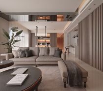 Wide ranges of materials (cold marble, warm wood, and soft leather) stack to create layers to the space, infusing contemporary architecture's sense with sensibility.