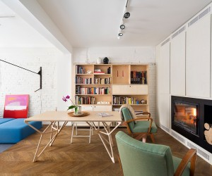 The living room features a bespoke plywood table that can also perform duties as a workspace or a dining table.