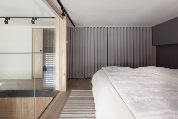 "A simple curtain pulls over the closet, creating texture as a floor to ceiling ""wall"" while eliminating visual clutter."