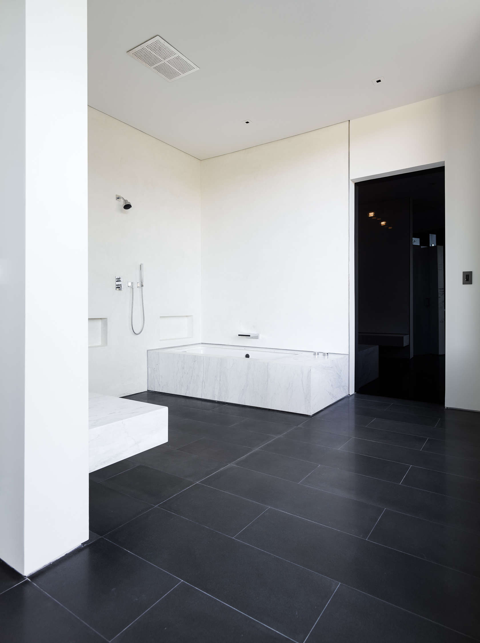 Black Tile Bathroom - An upside down beverly hills home with a minimalist exterior