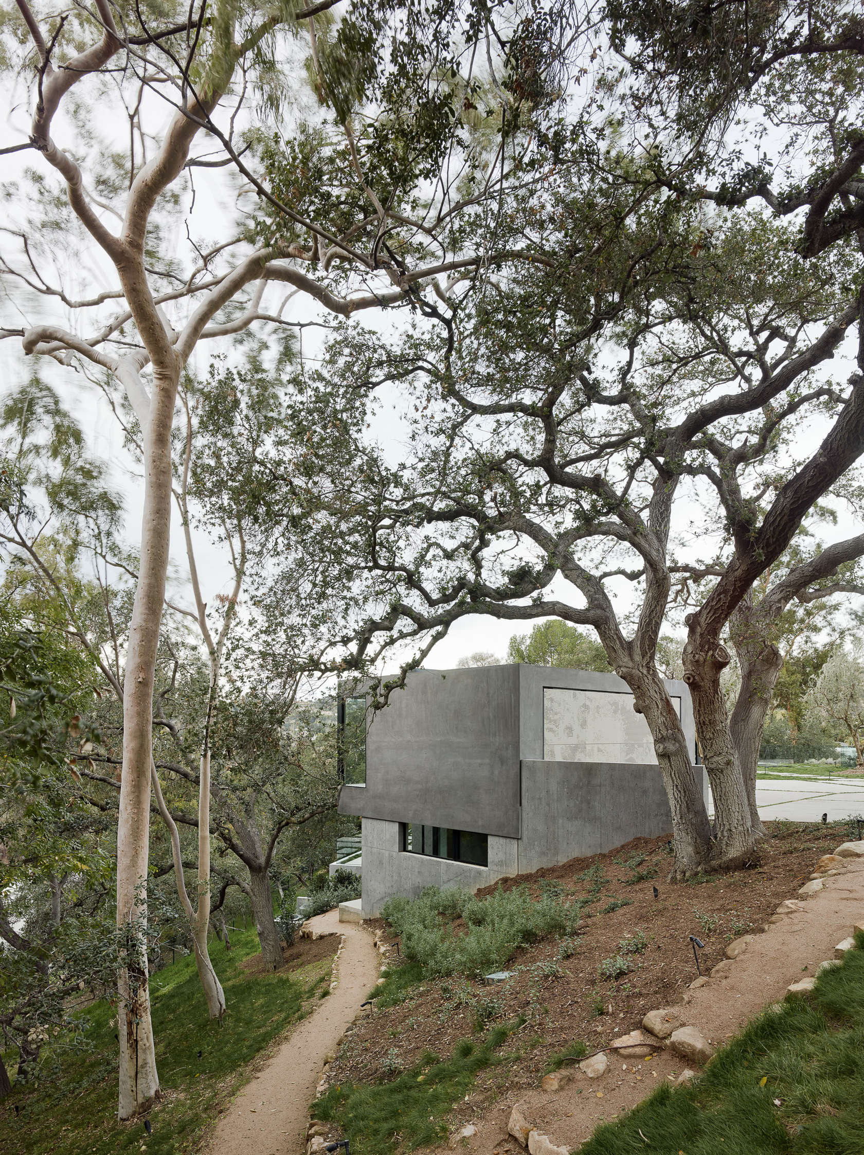 Cocrete Home Exterior - An upside down beverly hills home with a minimalist exterior