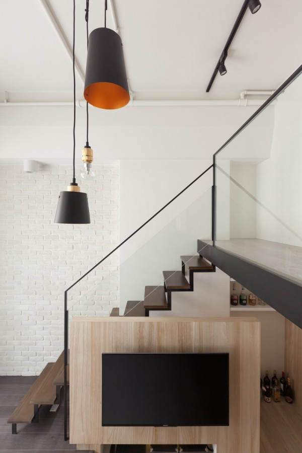 Who wouldn't love those pops of orange? And at the main level, you'll see open storage which is being used as a bar. Once can easily imagine this couple entertaining.