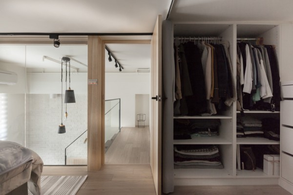 Open closet storage allows for plenty of space for belongings, but, should you choose, you can hide that dressing area.