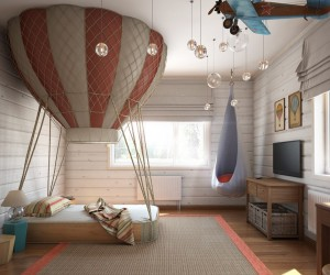 In the third room we have what can only be described as the most enviable child's bed design we've ever seen. The hot air balloon-inspired look is straight out of a storybook and is sure to be the source of many sweet dreams. The airborne theme is carried through the rest of the room as well with a hanging biplane and a dangling hammock chair for the ultimate in coziness.