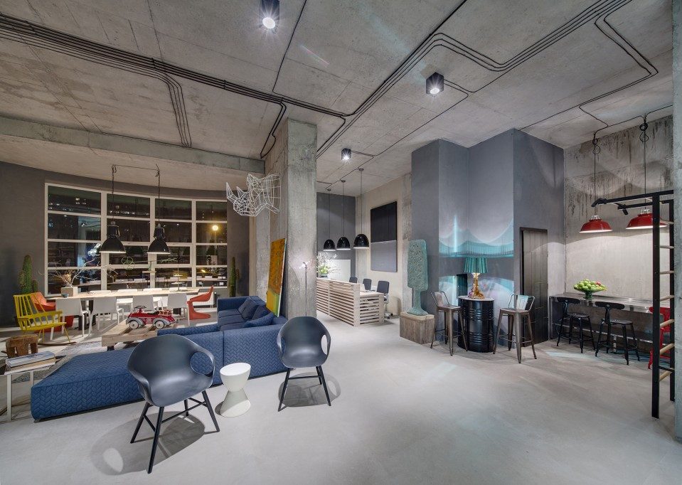 A modern office space that looks like an urban loft for Industrial design company