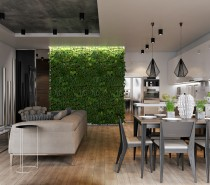 In this first home, one wall in the kitchen, stretching from the floor to the ceiling, is covered in plants. In an otherwise neutral toned open home that utilizes gray, white, brown, and black, the pop of vibrant green is instantly eye catching. In order to the keep the plants alive and thriving indoors, creative measures must be taken. Here, a skylight above the wall allows for natural sunlight to stream in all day.