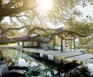 The house is situated on 3.5 acres, overlooking Oak Pass. The house itself measures 8000 square feet (743 square meters), though its hidden design makes it appear smaller. The property is home to more than 130 oak trees, which were an integral part of designing the home. Not only did the architect and homeowners want a space that could easily look out upon this spectacular private forest, but they wanted an exterior that itself did not draw attention away from the beautiful natural surroundings.